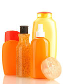 Cosmetics bottles and soap isolated on white — Stock Photo