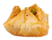 Sweet baklava isolated on white — Stock Photo