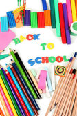 The words 'Back to School' composed of letters with various school supplies close-up isolated on white — Stock Photo