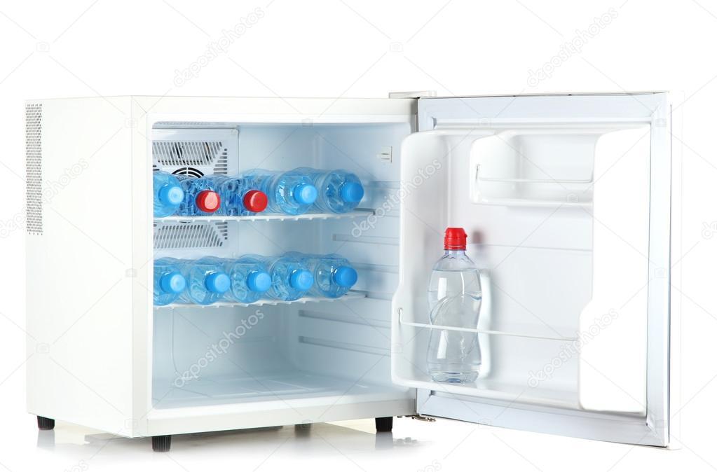mini frigo rempli d 39 eau en bouteille isol sur blanc. Black Bedroom Furniture Sets. Home Design Ideas