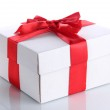 Gift box with red ribbon, isolated on white — Stock Photo #15674375