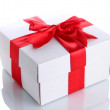 Gift box with red ribbon, isolated on white — Stock Photo #15674381
