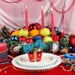 Serving Christmas table on white and red fabric background — Stock Photo #15670183