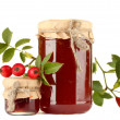 Stock Photo: Jars with hip roses jam and ripe berries, isolated on white