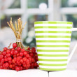 Tewith red viburnum on table on bright background — Stock Photo #15671039