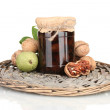 Jam-jar of walnuts on wicker mat — Stock Photo