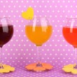 Colorful cocktails with bright decor for glasses on purple background with polka dots — Stock Photo #15671611