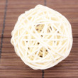 Wicker bamboo ball on bamboo mat — Stock Photo