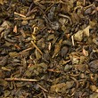 Stock Photo: Aromatic green dry tea, close up