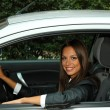 Beautiful young woman in car — Stock Photo