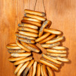 Stock Photo: Tasty bagels on rope, on wooden background