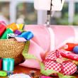 Sewing machine and fabric on bright background — Stock Photo