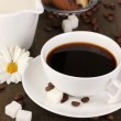 A cup of strong coffee and sweet cream on wooden table close-up — Stock Photo