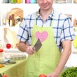 The young man in kitchen preparing — Stock Photo #15675001