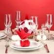 Table setting in red tones on color background — Stock Photo #15675305