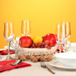 Table setting in red tones on color background — Stock Photo