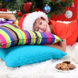 Little boy in Santa hat with milk and cookies for Santa Claus — Stock Photo #15675429