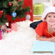Little boy in Santa hat writes letter to Santa Claus — Stock Photo #15675487