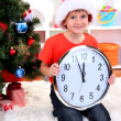 Little boy with clock in anticipation of New Year — Foto Stock