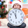 Little boy with clock in anticipation of New Year — стоковое фото #15675527