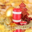 Red candle with christmas decoration on bright background — Stock Photo #15675777