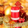 Red candle with christmas decoration on bright background — Stock Photo #15675785