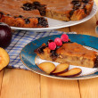 Tasty pie on plate on wooden table — Stock Photo