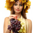 Beautiful young woman with yellow autumn wreath and grapes, isolated on white — Stock Photo #15676009