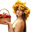Beautiful woman with wreath and basket with apples and berries, isolated on white — Stock Photo #15676023
