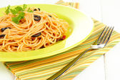 Italian spaghetti in plate on wooden table close-up — Stock Photo