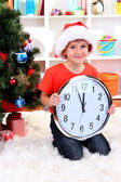 Little boy with clock in anticipation of New Year — Zdjęcie stockowe