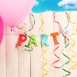 Party. Balloons against a wooden fence on sky background — Stock Photo