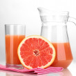 Grapefruit juice and grapefruit isolated on white — Stock Photo
