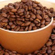 Coffee beans and cup close-up — Stock Photo #15735913