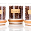 Coffee beans in jars isolated on white — Stock Photo #15735919