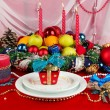 Serving Christmas table on white and red fabric background - Foto Stock