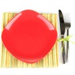 Empty red plate with fork and knife on colorful napkin, isolated on white — Stock Photo #15736667
