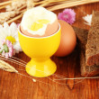 Stock Photo: Boiled eggs on wooden background