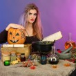Halloween witch preparing poison soup in her cauldron on color background — Stock Photo #15737653