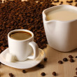 Stock Photo: A cup of strong coffee and sweet cream on wooden table close-up