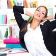 Business woman relaxing in office — Stock Photo