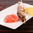 King prawn skewers on plate with ginger and lemon — Stock Photo