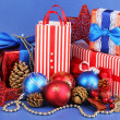 New Year composition of New Year's decor and gifts on blue background - Stock Photo