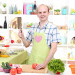 The young man in kitchen preparing — Stock Photo
