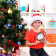 Foto de Stock  : Little boy with clock in anticipation of New Year