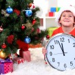 Little boy with clock in anticipation of New Year — Stock Photo #15739147