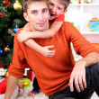 Father and son near Christmas tree — Stock Photo #15739153