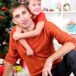 Father and son near Christmas tree — Stock Photo #15739163