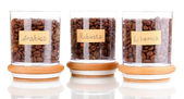 Coffee beans in jars isolated on white — Stock Photo