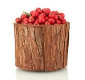 Hawthorn in wooden bowl isolated on white — Stock Photo